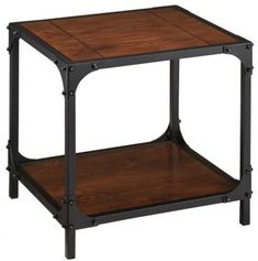 For his side of the bed he wanted something masculine, something that would go with the industrial looking breakfast table. This fit the bill perfectly, with plenty of room for a lamp, a clock, and the framed photo of their honeymoon in Venice. His vintage stack of Jules Verne and Victor Hugo books fit comfortably underneath. #HomeDecorators    Industrial Empire End Table