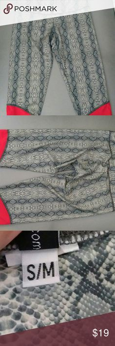 Onzie cropped snake print leggings NWOT These leggings are grey snakeskin print with a orange pinkish cuff at bottom. 82% polyester 18% Spandex. Waist is approximately 13 1/2 Inches Inseam 17 inches. Onzie Pants Leggings