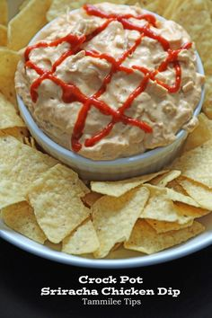 Cheesy Crock Pot Sriracha Chicken Dip Recipe! This slow cooker appetizer recipe is the perfect super bowl appetizer! Easy to make and tastes amazing.
