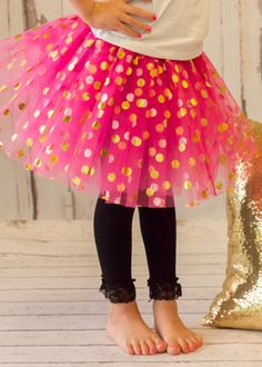 """Each Gold Polka Dot Baby Tutu is made of three layers of soft, fluffy tulle  covered with large gold polka dots, and a satin-covered elastic waistband.  The waist measures approximately 10"""" relaxed and will stretch to about 23""""  in circumference. The tulle skirt measures about 7.5"""" in length. We  recommend this tutu for infants and toddlers up to about 2 years old."""