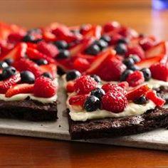 Brownie Pizza  1 box brownie mix & ingredients on box  8 oz cream cheese  1/3 c sugar  .5 tsp vanilla  4 c sliced fruit  1/2 c apple jelly    1. Heat oven to 350°F. Grease pan w/ cooking spray. Cook brownies 18-20 min. til done. Cool completely, 1+ hour.  2. Beat cream cheese, sugar & vanilla w/ on medium til smooth. Spread mixture over brownie. Top w/ berries. Stir jelly til smooth; brush over berries. 3. Refrigerate til chilled. Store in fridge.