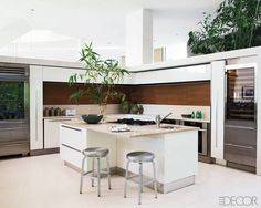 The freestanding kitchen walls are sheathed in carved-limestone tiles.