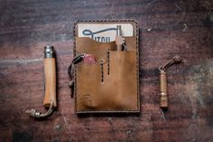 This handcrafted notebook wallet is made to order.  Cut, stitched, & burnished with great care by human hands.     Crafted with 5oz American tanned Wickett & Craig leather, one of the last specialty tanneries in the country, this exquisite & durable leather will not only endure but get better with age.    Fits:  (1) Field Note, Moleskine, Passport, or other 3.5 x 5 journal.   (1) Small Pocket Knife ( Swiss Army Cadet, Buck 55 and many more)  Email me for models  (1) Pen or pencil ...