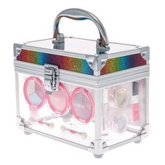 <P>This clear case with a glitter rainbow lid comes with a pretty set of makeup inside. It includes 6 eyeshadows colors, 1 pink blush, 1 light pink and 1 dark pink lip gloss, 1 light pink lipstick,1 glitter mascara, and 1 silver and 1 gold glitter pod. Perfect for creating cheerful looks for school or parties.</P><UL><LI>Includes: 2 x 3 well eyeshadow palettes, 1x blush, 1 x mascara, 2 x lip glosses, 1 x lipstick, 2 x glitter pods <LI>Includes: 1 x blush brush, 2 x dual-ended sponge…