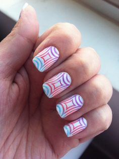 detailed nail designs are popping up everywhere.. i really like this trend since i always have my nails done.. the use of different colors and shapes is really cool