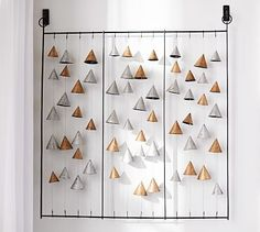 I love this concept. Could use anything and hang indoors or out.Metal Cones Wall Art #potterybarn