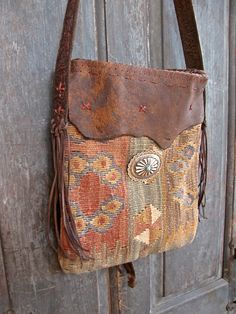 Hand woven Kilim bag with sterling silver conchos and leather detail.