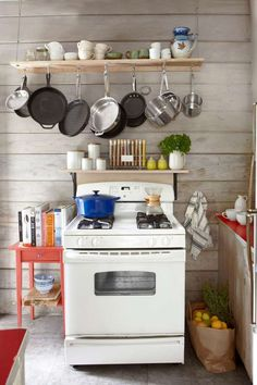 Custom spice and pot racks were fashioned for this California cabin kitchen. - Victoria Pearson