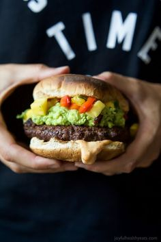 Smoky Avocado Burgers topped with a Pineapple Pepper Relish! These burgers don't run short on flavor, they are juicy, tender, mouthwatering basically everything you want in a Burger + more!   joyfulhealthyeats.com