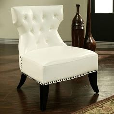 @Overstock - This accent chair is distinguished by its button tufted cushions and a cut back support that provides charming visual appeal. The leather upholstery and dark wood give this accent chair an upscale, smart look.http://www.overstock.com/Home-Garden/Bentley-White-Bonded-Leather-Chair/6014747/product.html?CID=214117 $259.19