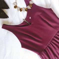 bar III dress Super comfy but very chic Bar III dress. Beautiful burgundy color, sleeveless, v-neck, exposed zipper in back. Stretchy and soft cotton fabric. Size large but fits more like medium. Recently dry cleaned and in very good condition! Bar III Dresses