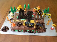 Construction site 4yrs old birthday cake. 4 is make with chocolate graham cracker crumbs