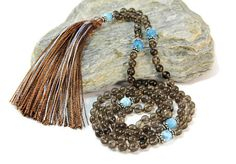 Stylish and sophisticated mala necklace. 108 semi precious stones of smoked quartz surrounded by aga