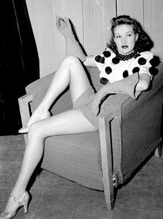 Betty Grable 1939 - showing those legs she was famous for...and wearing a jumper decorated with pom poms