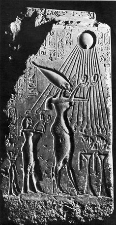 Relief of king Akhen-Aton and his wife Nefertiti praying to the sun-god Aton who provided his rays to the king and the queen. The sun rays end up with hands holding the key of life offering it to the royal family.