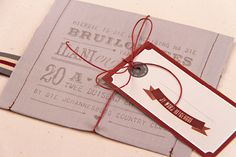 Chrystalace Wedding Stationery Grey and red material pocket invitation with inserts.