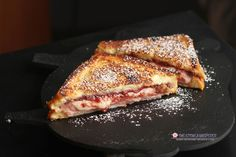 Classic Monte Cristo - You've not had an amazing grilled cheese sandwich until you've made this Monte Cristo!  Layers of salty ham, luscious gruyere cheese, tangy dijon mustard and sweet raspberry preserves dipped in this French toast mixture and then grilled to perfection!