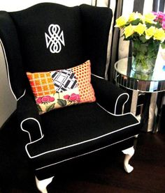 Yes! black (dark) wingback chair with white piping from Design Sponge (shown on Addicted Decorating)