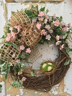 Spring Wreath with Nest, Front Door Wreath, Easter Wreath, Pink Wreath, Summer Wreath This open and airy Spring wreath is filled with pink silk flowers, various greens, an open-weave burlap bow and a nest with eggs. It will bring a breath of Spring to your home. It can enhance you