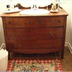 this looks exactly like the dresser i have that was my grandma's. Want to put a copper sink in it!!!! (Jessi!)