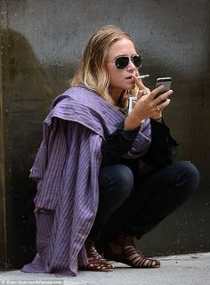 Her favourite outfit: Mary-Kate Olsen once again took a smoke break wearing the same the w...