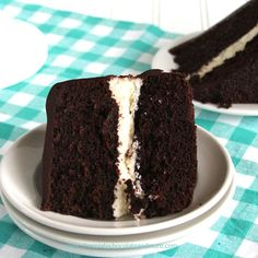 Ding Dong Cake-rich devil's food cake, a vanilla cream filling and smothered in chocolate ganache! Ding Dongs, Ring Dings, Swiss Rolls, Hostess Cakes. They are all pretty much the same snack. Chocolate Cake, a cream filling and then covered in chocolate. As a kid, we always begged for mom to buy them for our school lunches....