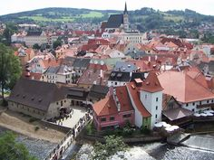 "Czech Republic: Cesky Krumlov. ""A living town where people go about their business along twisting and cobbled alleyways. Towering over the city is Schwarzenberg Castle, one of Europe's largest."""