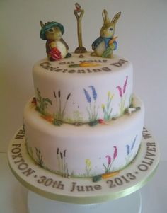 Five layers of vanilla sponge arranged in two tiers and sandwiched together with whipped vanilla frosting. Decorated with hand painted sugar paste sculptures of Benjamin Bunny, Peter Rabbit and some of their stolen vegetables! 100% edible