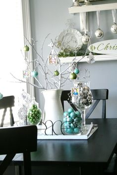 same color ornaments in glass containers, vases, jars, set on table