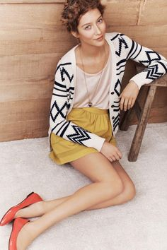 MK I AM DYING over the mix of the sophisticated with the aztec print of the sweater.