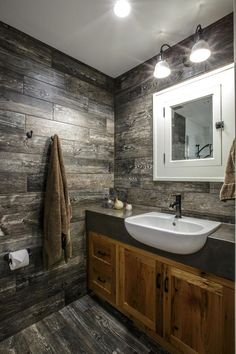 The wormy chestnut vanity in this bathroom was topped with a thick concrete top and semi-recessed sink