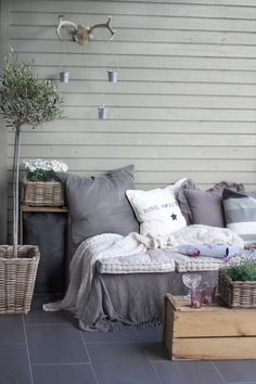 Cute outdoor nook - love the daisies, textures, repurposed crates & horns.