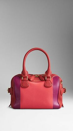 The Burberry Mini Bee Bag in Hand-Painted Leather in Bright Peony Pink. A hand-painted mini bag in grainy leather with a vivid stripe artwork. The bag features a double-layered construction with concealed wing pockets for easy access, while the grosgrain interior has two pockets and leather-bound seams. Discover women's bags at Burberry.com