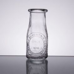 This Libbey 70355 Farmhouse 7.5 oz. glass heritage bottle is perfect for your breakfast buffet or hotel room service! Fill it with milk, juice, or water for a cozy, home-style presentation. With its imprinted logo and classic shape, this milk bottle design brings a nostalgic feel while embracing a trendy, farm-to-table look! Thick walls and thick round rim give the bottle increased durability and an extended service life, ensuring that it will become a staple at your establishment. The…