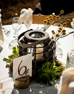 like the idea of lantern or light with flowers around  WeddingChannel Galleries: Rustic Centerpieces