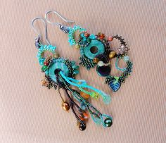 Swamp Beauty Asymmetric Freeform Peyote Dangle Earrings sold but she does have a tutorial Gordon $6.75 on Etsy. These are so colorful