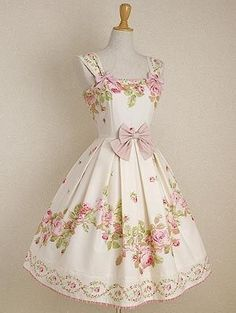 1950s White dress with pink and green floral details Minus the bows