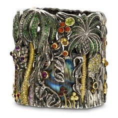 "Jean Boggio  - Jungle Green  .... ""Extraordinary Garden "" Lyon jeweler and goldsmith by training, Jean Boggio has worked with leading brands such as Baccarat, Haviland, Lapidus, and even Artus-Bertrand Le Bourget. Baroque universe inspired by tales and legends and monumental rings, his fantasy world. Cuff bracelet in silver, yellow gold, opal, amethyst, colored sapphires, green peridot and garnet."
