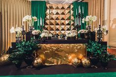 Gold and Emerald Green Backdrop with Gold and Black candleabra and candleholders Now Available @idesignevents