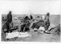 French and Arab soldiers making bread at their camp in the Jordanian desert, 1918.