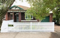 First impressions count! So up your street cred with this contemporary take on the picket fence, complete with a sleek letterbox. Backyard Fences, Garden Fencing, The Hamptons, Garage Doors, Deck, Contemporary, Outdoor Decor, House Ideas, Home Decor