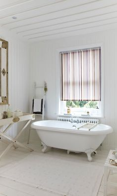 Stripes bring splash of colour into a white bathroom, keep the rest of the decor neutral to really make an impact.