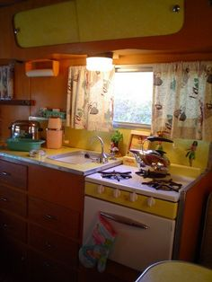 1957 corvette trailer - interior.. i love this! I always did like the '57 'vette - but it was the car! Had not heard of these, but will be looking for more of them. Want to see an exterior shot!  Love the yellow!!