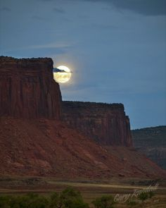 The full moon over the mesas of Canyonlands National Park, Utah, USA
