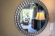 Mirror with a reflection of one of the bedrooms in this home for sale in Paarl.