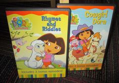 LOT OF 2 DORA THE EXPLORER DVD, RHYMES & RIDDLES & COWGIRL DORA, GUCWS