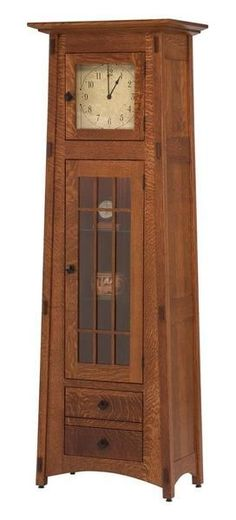 Amish Mission Clock Cabinet Stunning mission style clock cabinet that offers storage to boot. Supported by premium quality materials and fine Amish craftsmanship. Beautiful choice for office, living room, bedroom and more! #clocks #clockcabinet