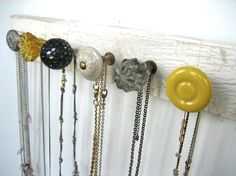 Round handles on a board makes a great necklace hanger.