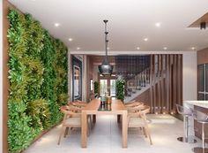 table et chaises salle à manger en bois et mur végétal intérieur