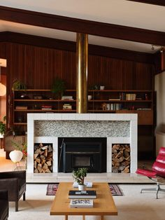Another look at the fireplace with its brass chimney cover and floating marble hearth. #dwell #midcenturymodern #realestate #newzealand